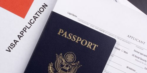 Directly above photograph of an application for a visa.